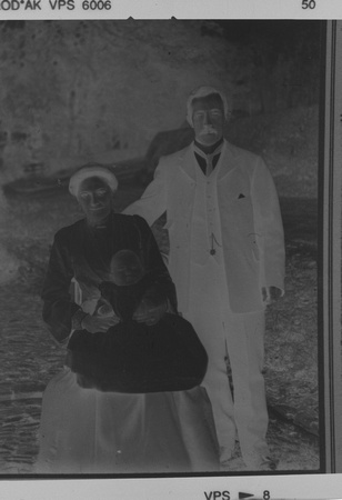 A scanned glass negative of my Great Grandfather, Great Grandmother and Grandfather (as a baby)